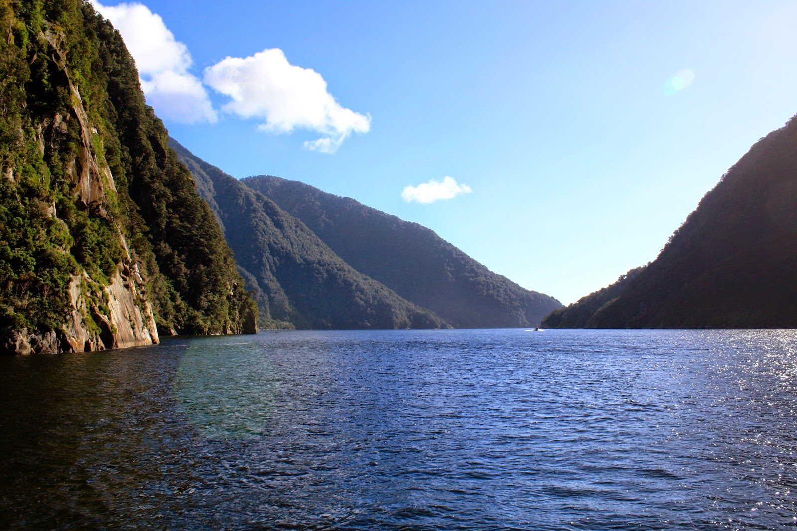 Steep hills and black water in Milford Sound.