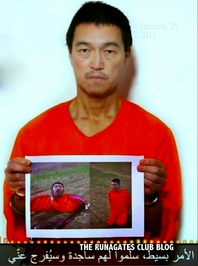 Kenji Goto displays the photo of beheaded ISIS hostage Haruna Yukawa