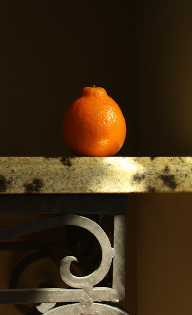 fruit, photography, still-life, tangelo, orange, light, sunlight, granite, iron, mannerist