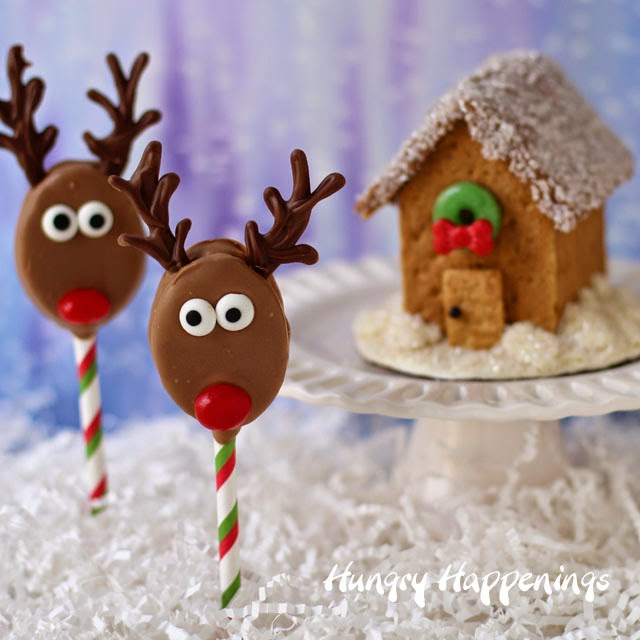 Spend time during the holidays crafting in the kitchen making these adorable Honey Maid and Skippy Reindeer Pops and Graham Cracker Houses | HungryHappenings.com