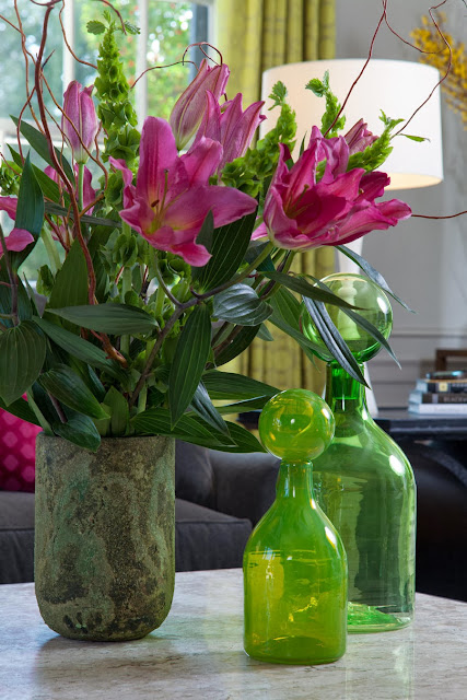 green hues balance out the magenta flowers and present a much fresh ambiance into the space