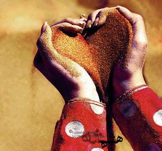 heart sand in hand of girl