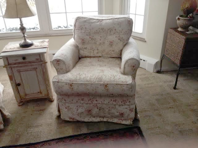 Before Picture Of Chair With Faded Floral Slipcover.