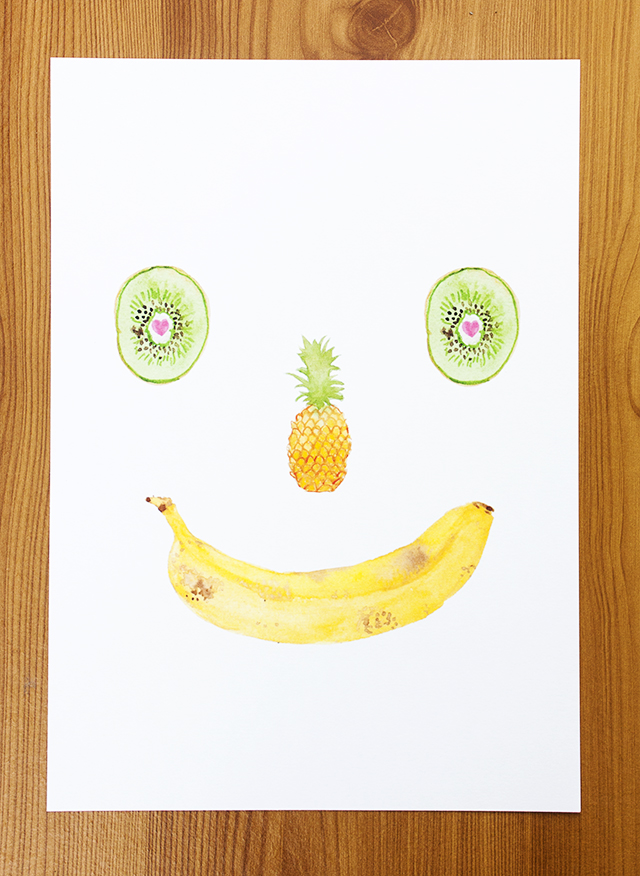 print of watercolour painting of smiling fruit - kiwi, pineapple and banana