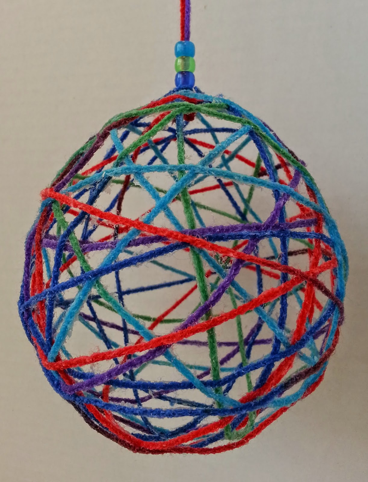 DIY Hanging Fiber Ball - Photo courtesy of Hands On Crafts for Kids.