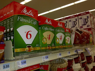 Packages of cone coffee filters on store display