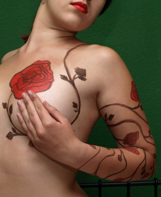 are one of the most popular flowers used in floral tattoo designs  title=
