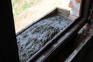 Cement goes in for the new windowsills