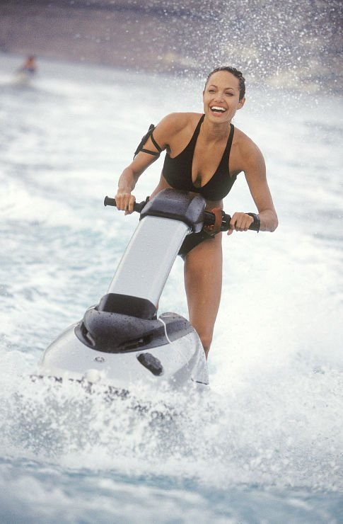 Angelina Jolie on a jet ski in Lara Croft Tomb Raider: The Cradle of Life movieloversreviews.blogspot.com