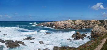 Atlantic rocky coastline, showing a surf area. Porto Covo, west coast of Portugal