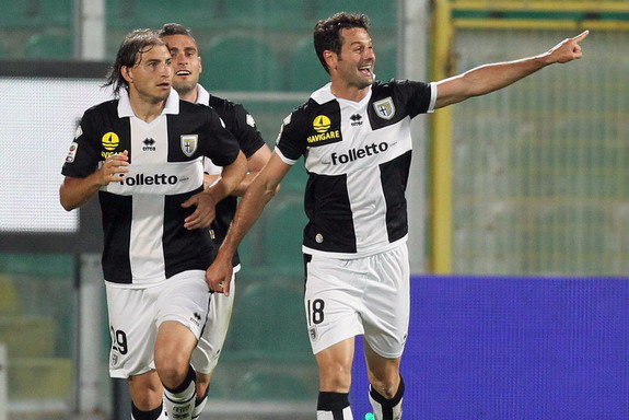 Massimo Gobbi celebrates with Parma teammates after scoring the opening goal against Palermo