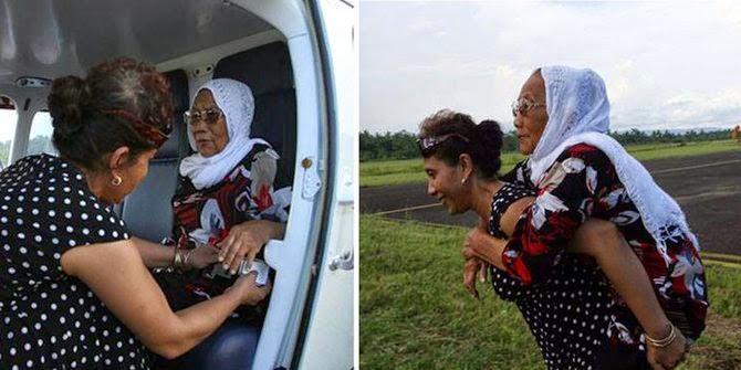 Menteri Susi Gendong Orang Tua Naik Pesawat Baru