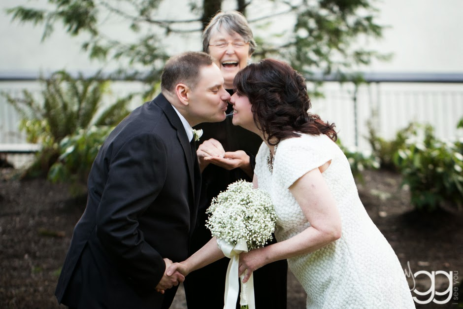 Linda and David seal their vows with a kiss - Posted by Patricia Stimac, Seattle Wedding Officiant