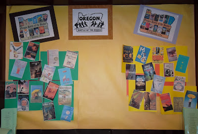 Poster board displaying logos: Oregon Battle of the Books, third- to fifth-grade and sixth- to eighth-grade divisions, with cover reproductions of featured titles