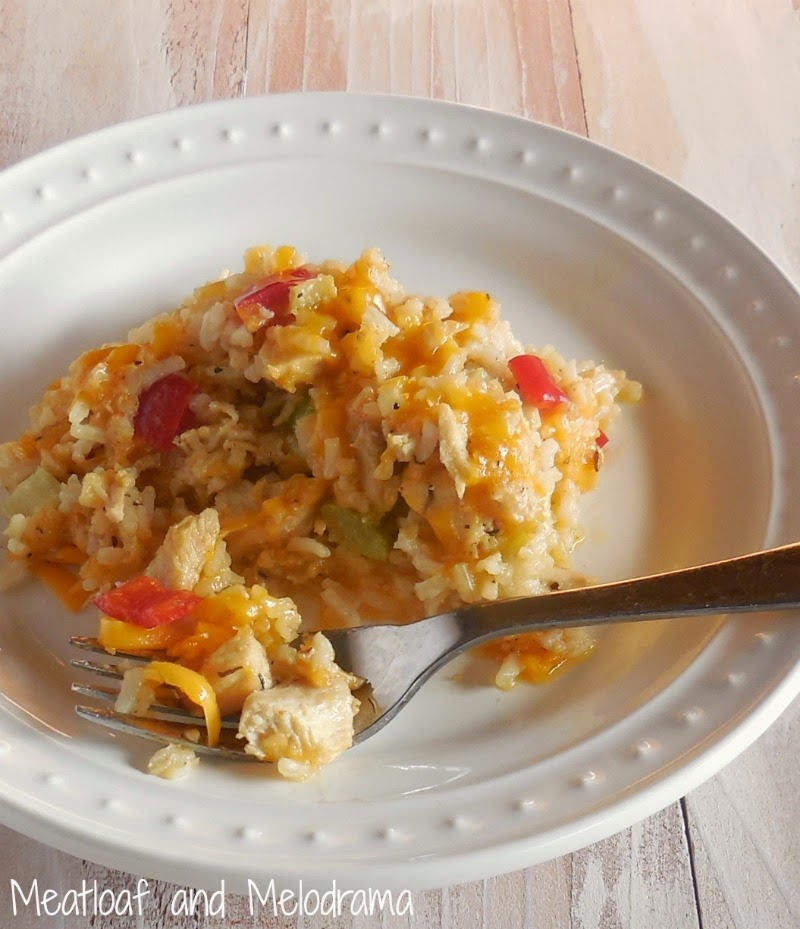 healthy chicken and rice casserole with peppers, celery and cheese