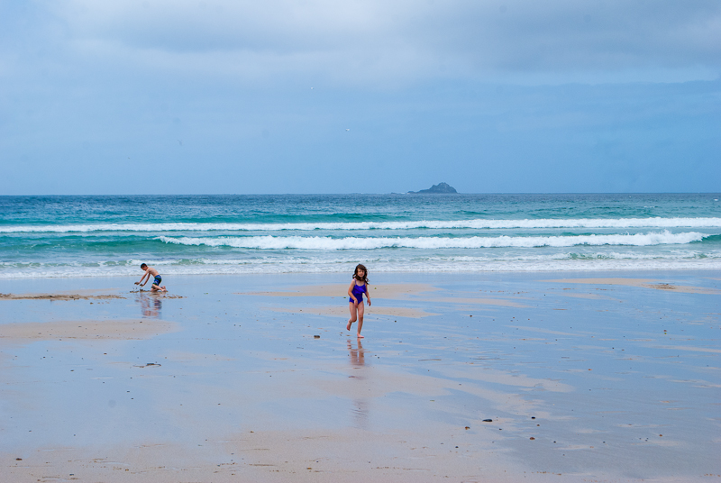 Children playing on the beach in sennen cove west cornwall, england, UK