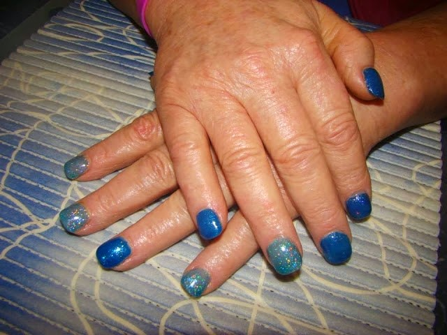 Acrylic back-fill Manicure in beautiful deep blue sapphire glitz aqua glitz gold tapped on glitz