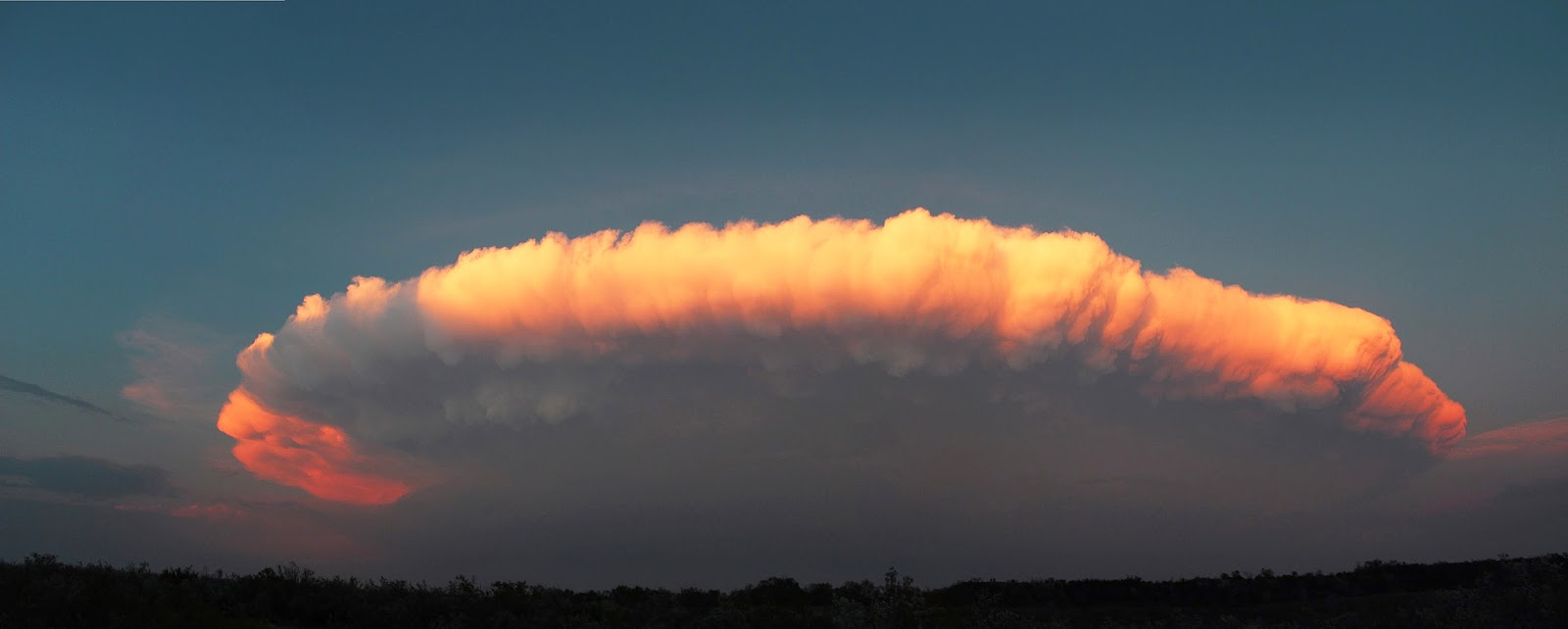 Cumulonimbus Cloud over Texas Cumulonimbus Cloud over Texas   A little later, as the sunset, the storm looks quite different. This kind of complete view of a thunderstorm cloud is typical of the US Great Plains.  Texas, United States May, 2012  Image Credit & Copyright: Kay Cunninghan