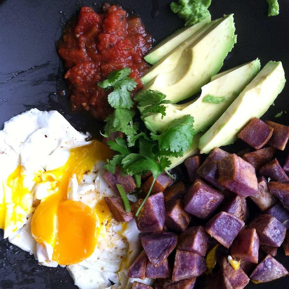 Yummy breakfast: Pan fried blue potatoes, over easy egg, avocado and salsa