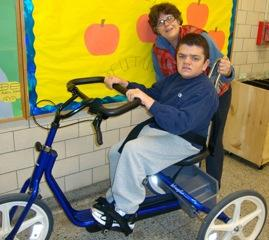 Susan Maltz observes Matt as he rides his bike at the BEST Program.