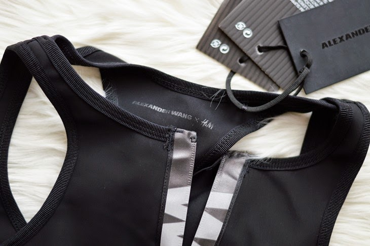 Alexander Wang x H&M designer collaboration full collection pictures photos Sport Bra with cut-out sections at back zip with reflective tape and logo at front thesparklingcinnamon