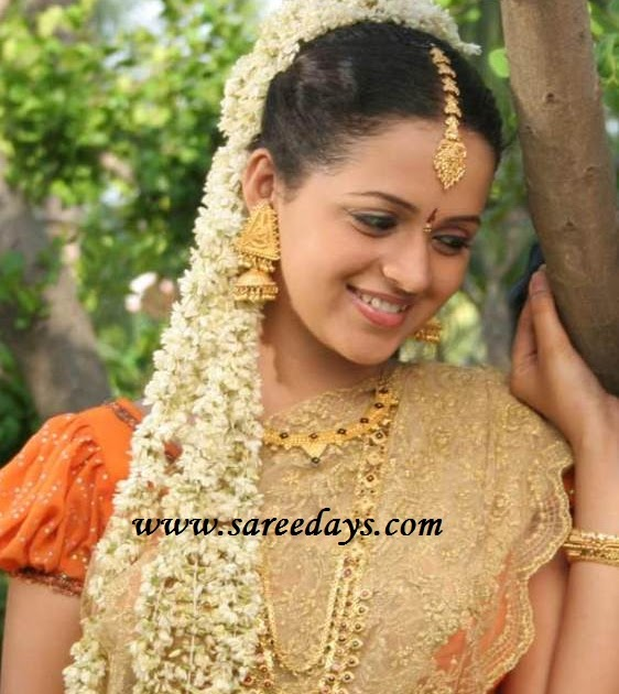 Latest saree designs bhavana in designer beige netted saree altavistaventures Images