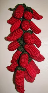 http://www.ravelry.com/patterns/library/crocheted-chili-pepper-ristra