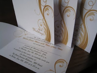 Floral gold swirl wedding invitation