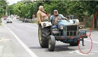 funny picture: grandma holds tractor in balance