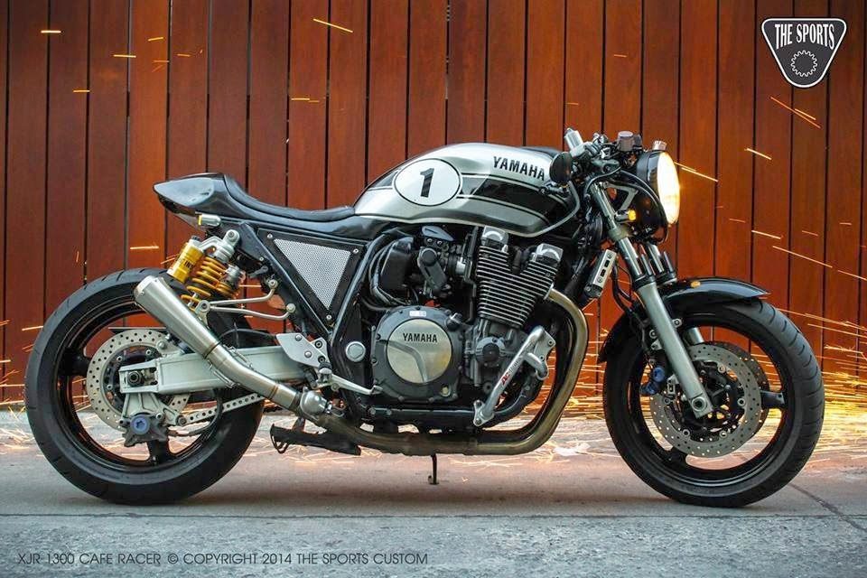 Yamaha XJR1300 Cafe Racer. Yamaha Cafe Racer by The Sports Custom based on a Yamaha XJR1300. Yamaha XJR1300 Cafe Racer looks extremely massive and sporty. Yamaha Cafe Racer conversion (Yamaha XJR1300 Cafe Racer) Yamaha Cafe Racer seat, Yamaha Cafe Racer tank, Yamaha XJR1300 clip on handle bar, Yamaha Cafe Racer rear set, Custom LED tail lamp, Yamaha Cafe Racer seat cowl, Custom LED turn signals, Custom motorcycle leather work, Custom Megaphone exhaust ( Cafe racer Exhaust), Custom bar end mirrors,