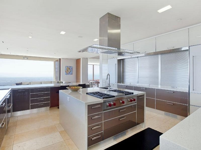 Photo of kitchen with big island in the middle
