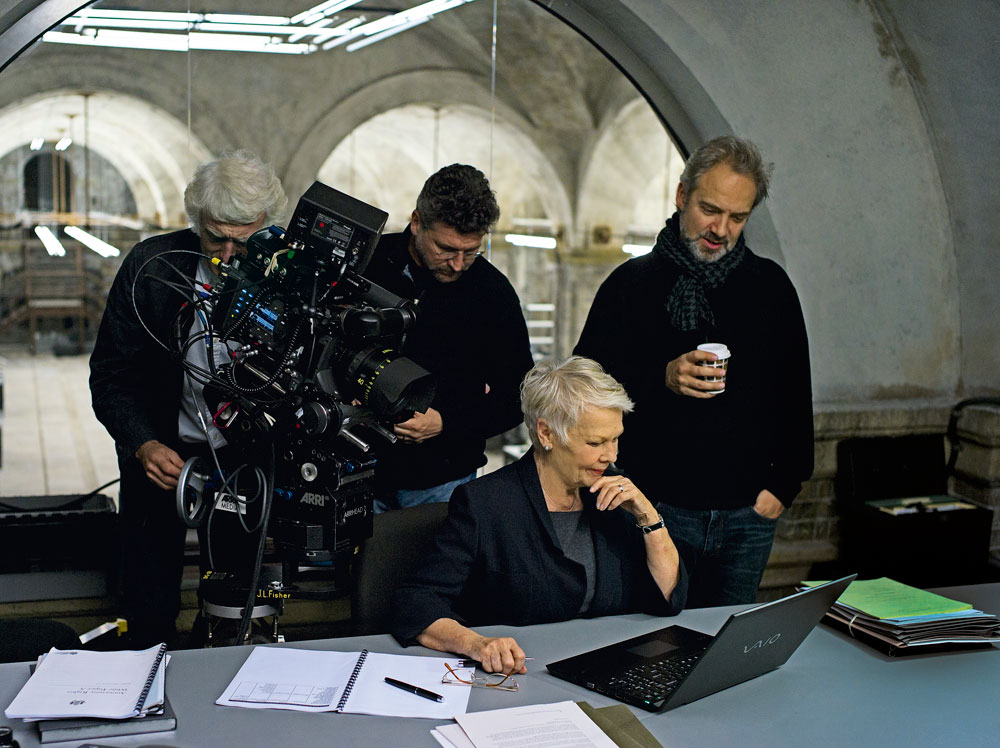 Judi Dench as M on the Skyfall set with Sam Mendes, Roger Deakins, Alexander Witt