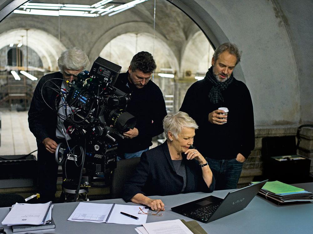 Judi Dench as M on the Skyfall set with Sam Mendes, Roger Deakins, Alexander Witt