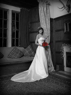 Bride Dawn in white wedding dress posing at the fireplace on her wedding day in scotland