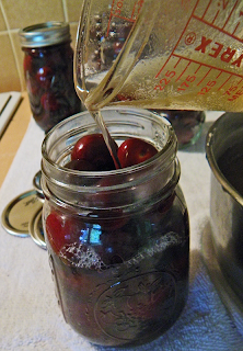 Hot Honey Sauce Being Poured Over Cherries
