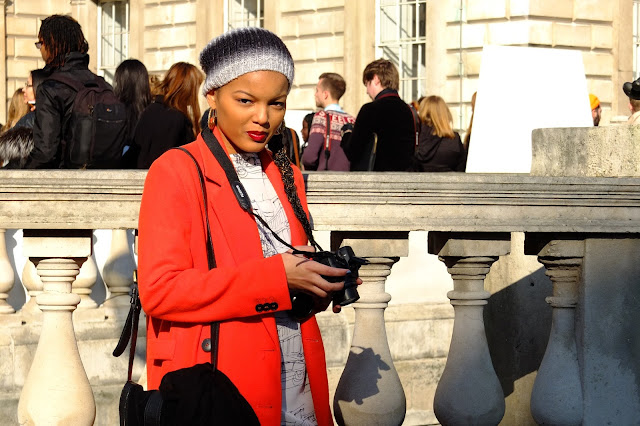 Photography wearing orange coat and beanie at lfw style street photography
