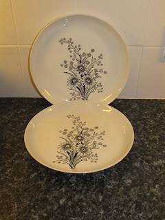 Vintage 1960's Arabia of Finland dinner plates with black and white floral design.