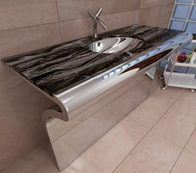 an extraordinary stainless steel bathroom sinkshanging in the brown ceramic wall with modern water tap