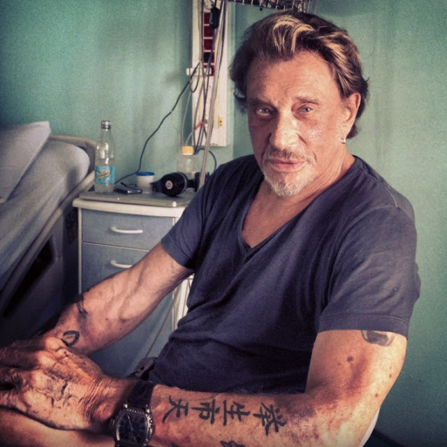 tatouage avant bras johnny hallyday