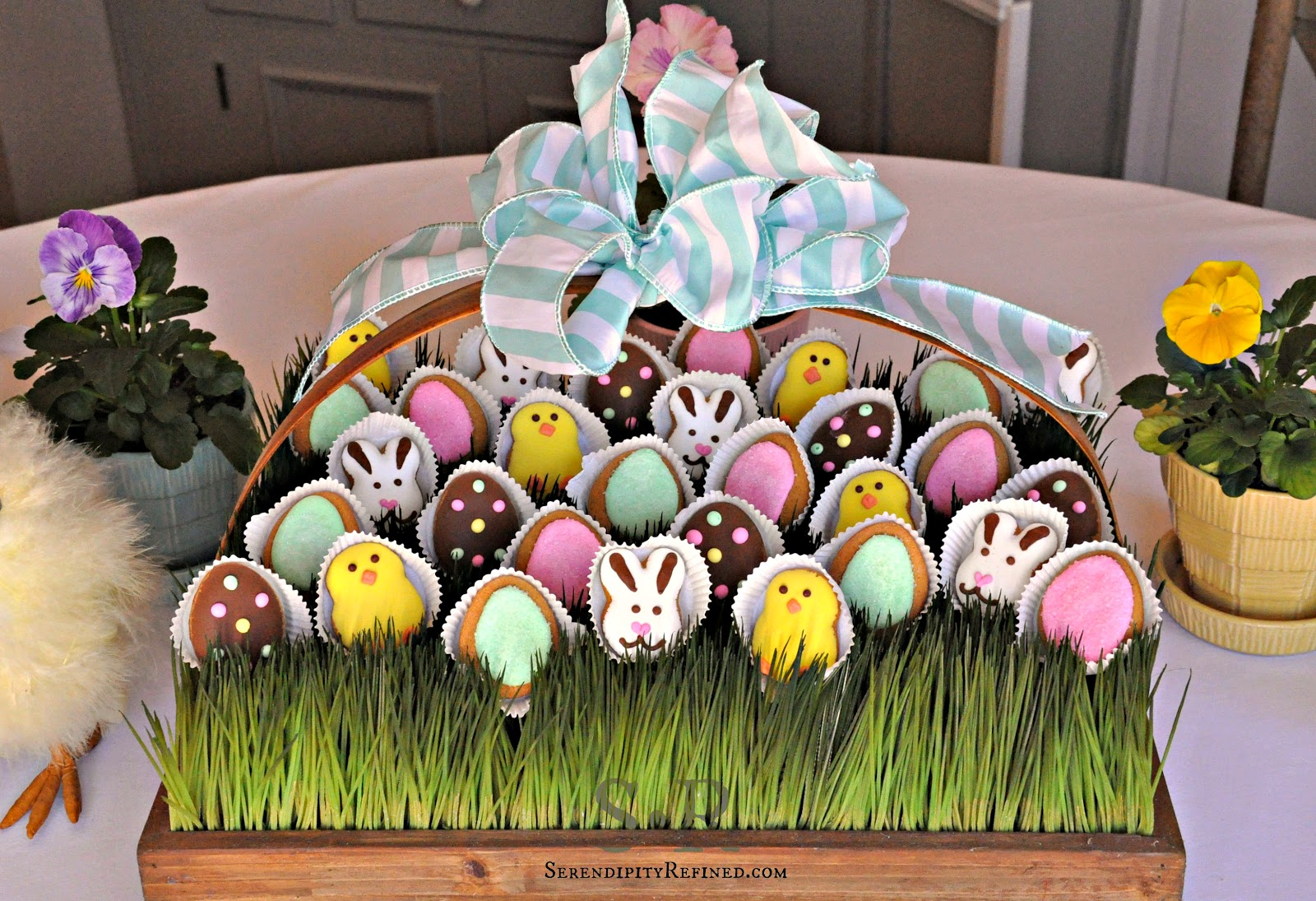 Serendipity refined blog pastel spring edible easter table decorating using an easter basket filled with colored eggs cookiescandy or chocolate is a simple and inexpensive way to create a centerpiece negle Choice Image