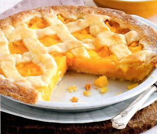 Mango and almond tart with crisscross pastry in a flan tin