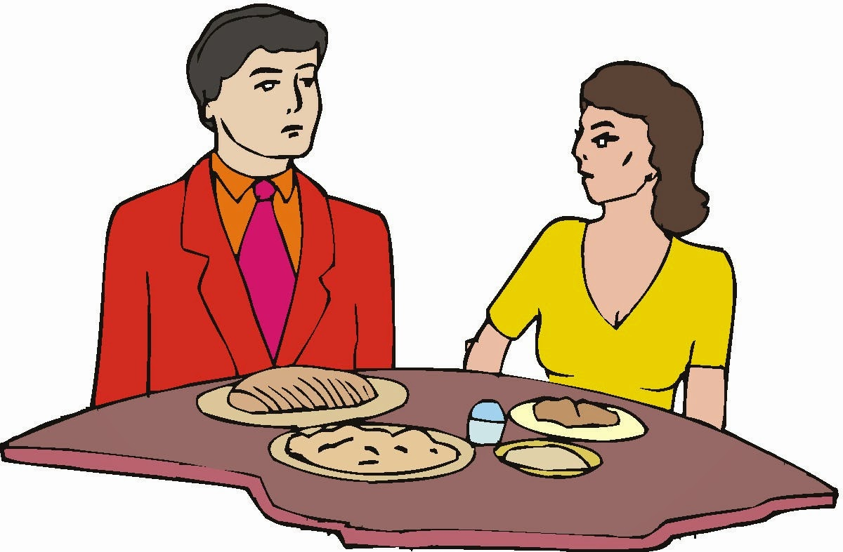 Man-woman-at-table-with-meal