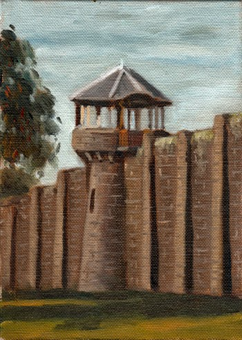 Oil painting of a bluestone prison wall with a central watchtower and the leaves of a eucalypt to the left.