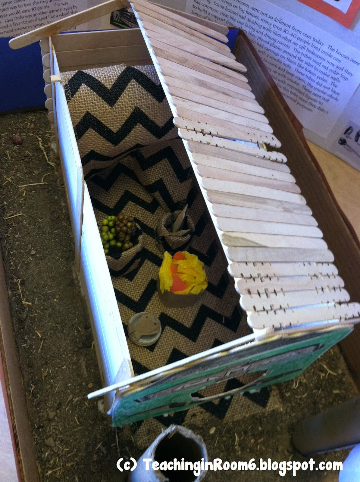 This Pre-Columbian Plank House was created by a 5th grade student.  It has a cut away on the roof to allow people to see the crafts of the tribe inside.