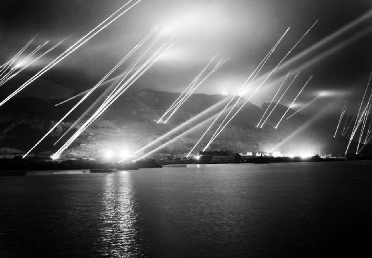 Searchlights in the night sky during an air-raid practice on Gibraltar, 20 November 1942.