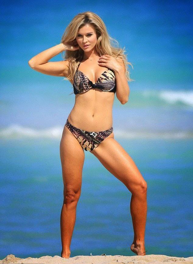 Joanna Krupa wears a Black Bikini at Miami on Tuesday, April 1, 2014