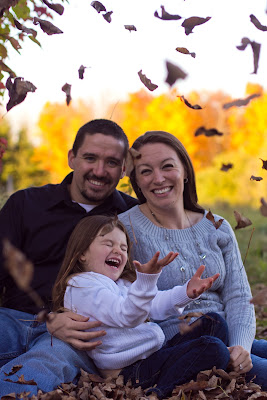 family photo throwing leaves up