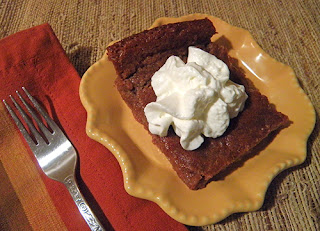 Slice of Persimmon Pudding with Whipped Cream