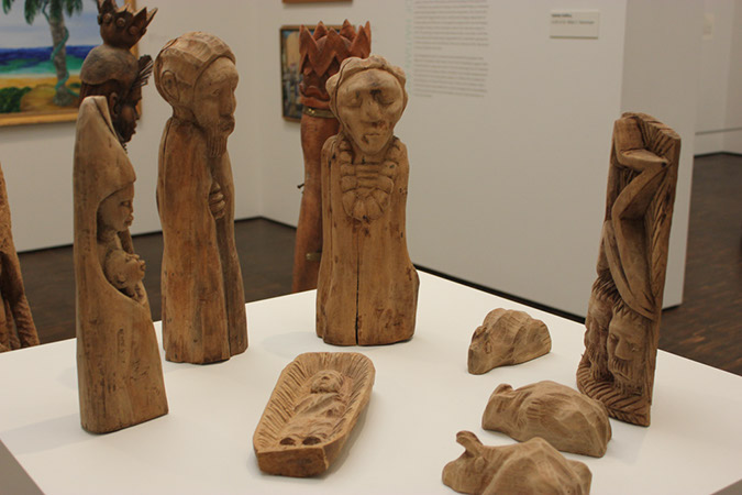 Photograph of small sculpture wood carvings representing the nativity scene.