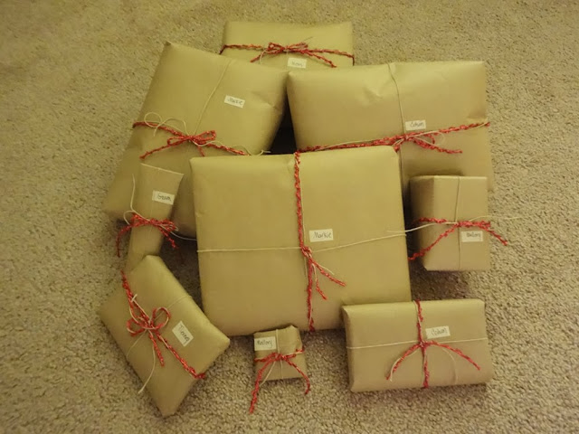 Presents wrapped in brown parcel paper, tied with hemp cord and red string